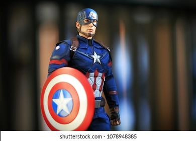 BANGKOK THAILAND - DECEMBER 17 ,2016 : Close up shot of Captain America Civil War superheros figure in action fighting. Captain america appearing in American comic books by Marvel.