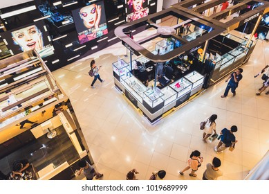 Bangkok, Thailand - December 17, 2017: People (unidentified) walk in Mega Bangna shopping mall, a top-down view. Mega Bangna is one of the biggest shopping centers in Thailand and Southeast Asia.