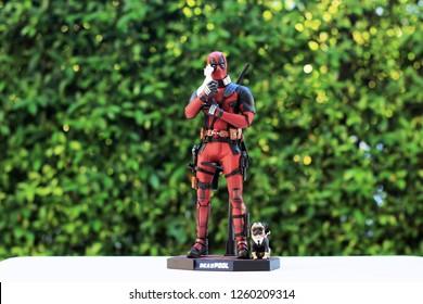 BANGKOK THAILAND - DECEMBER 17 ,2018 : Close up shot of Deadpool superheros figure in action holding unicorn ,model figure 1/6 scale