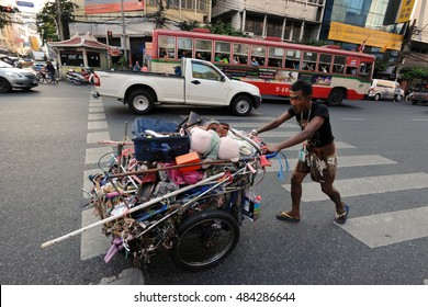 Bangkok, Thailand - December 18, 2013: A man transports discarded materials. Poverty remains a major problem in Thailand with the average wage under B200 or $4 a day.