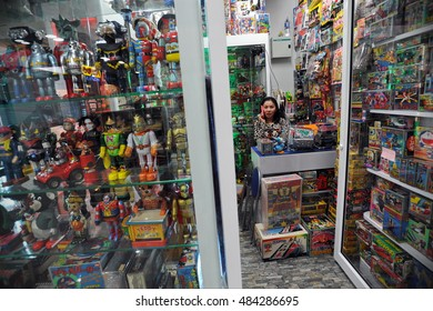 Bangkok, Thailand - December 18, 2013: A woman waits for customers at a toy store in Chinatown.