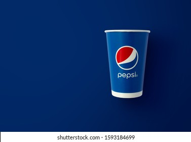BANGKOK, THAILAND - December 18, 2019: Pepsi paper cup with new Pepsi logo on blue background. Pepsi is a world famous carbonated soft drink. Illustrative editorial