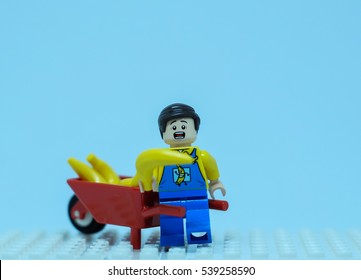 Bangkok Thailand. December 19, 2016. Lego mini story : Banana truck driver man with banana wheel barrow.
