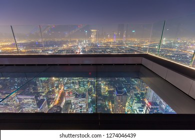Bangkok / Thailand - December 19 2018: Landmark highest outdoor observation, world's largest glass tray at 310 meters, sunset, night view skywalk in bangkok city king power mahanakhon duty free, hotel