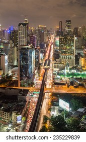 Bangkok, Thailand - December 2, 2014: Bangkok city night scenary with busy traffic and cloudy sky