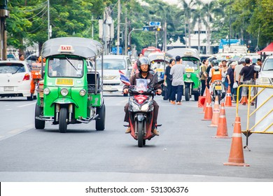 BANGKOK, THAILAND - DECEMBER 2, 2016 : Every day life in Bangkok, People with low income like to use Tuk Tuk and Amazing that once should not be missed when tourists in Bangkok..