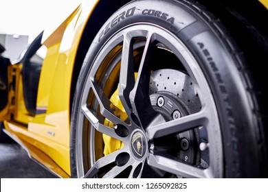 BANGKOK, THAILAND - December 20, 2018; Lamborghini Gallardo LP570-4 Superleggera sports rims with 19-inch forged aluminum wheels attached with titanium lug nuts wrap with Pirelli P Zero Corsa tires.