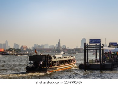 Bangkok, Thailand - December 21, 2017: Waterway traffic in Chao Phraya River. The Chao Phraya Express Boat, a transportation service in Thailand operating on the Chao Phraya River, Bangkok, Thailand.