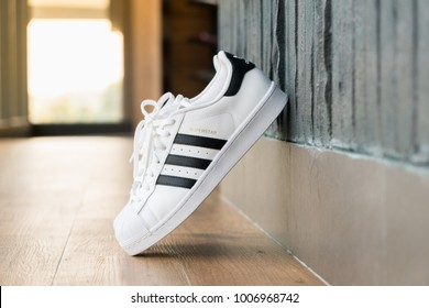 BANGKOK, THAILAND - DECEMBER 21, 2018 : The adidas Superstar shoe debuted in 1969 and quickly lived up to its name as basketball players league-wide laced into the shell-toe design.
