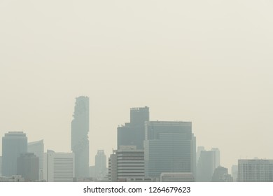 BANGKOK, THAILAND. DECEMBER 21, 2018: Air pollution effect made low visibility cityscape with haze and fog from dust in the air during sunset in Bangkok, Thailand.