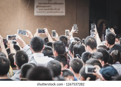 Bangkok, Thailand - December 21, 2018: Crowd at Assumption College Christmas Fair taking photo of members of BNK48, a popular idol group, before their performance.