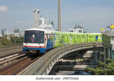 BANGKOK, THAILAND - DECEMBER 22: City train in Bangkok is arriving on the station, crowd under ramp is waiting for the bus, December 22, 2012 in Bangkok, Thailand