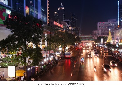 BANGKOK, THAILAND - DECEMBER 24, 2013: People drive in Bangkok. Bangkok is the biggest city in Thailand with 14 million people living in its urban area.