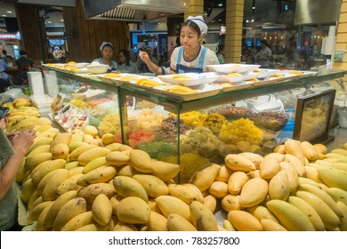 BANGKOK, THAILAND - December 26, 2017: Undefined asian seller sells mango dishes in a shopping mall Terminal 21 in Bangkok, Thailand