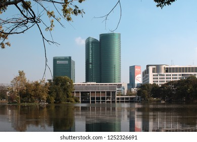 Bangkok, Thailand - December 27, 2015: Petroleum Authority of Thailand (PTT) headquarters and Ministry of Energy building photographed from Rod Fai Park with reflection from the small lake