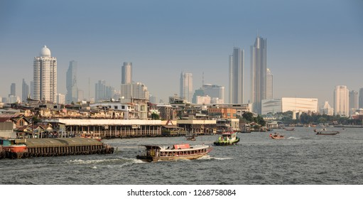 BANGKOK, THAILAND - DECEMBER 27, 2018 : View Of river traffice with buildings in Chao Phraya River in the afternoon time.