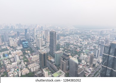 BANGKOK, THAILAND - December 28, 2018: Air pollution in Bangkok with PM2.5 air-quality index (AQI) reached dangerous level with dust and smog, seriously threatening to public health, rooftop view