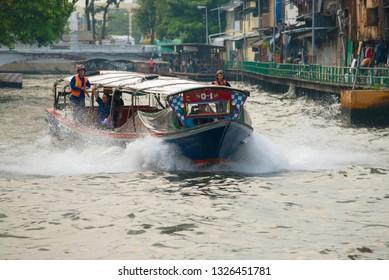 BANGKOK, THAILAND - DECEMBER 28, 2018: Passenger route boat on the city canal. Bangkok Transport