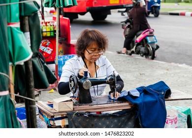 Bangkok, Thailand - December 29, 2008: A street tailor in Bangkok