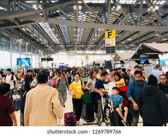 BANGKOK, THAILAND. DECEMBER 29, 2018: the passengers are waiting to check in at the airline counters of the departure hall at the Suvarnabhumi international airport for the new year holiday.