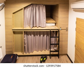 BANGKOK, THAILAND - December 29, 2018: Interior view of capsule bedroom in hostel. Capsule bedroom, bed in box or pod. Small simple bedroom interior design with modern and luxury style.