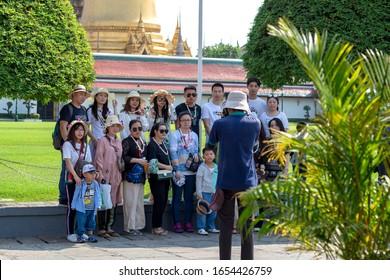 Bangkok, Thailand December 29,  2019 : Group of tourists on a tour in Bangkok