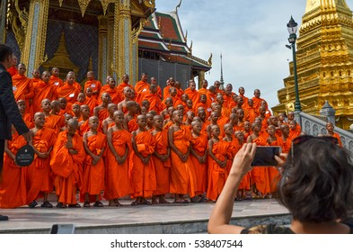 BANGKOK, THAILAND - December 3, 2016: [Young monks are arranged for a group photo in front of Prasat Phra Thep Bidon in Grand Palace - is the top tourist attractions in Bangkok]