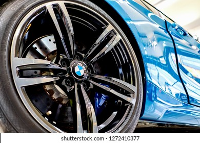 BANGKOK, THAILAND - DECEMBER 30, 2018: close up of shiny BMW M2 coupe rims. 19 inch M Performance black forged alloy wheel & M sports brake with compound brake discs. The 4 piston fixed calipers.