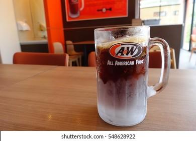 BANGKOK, THAILAND - DECEMBER 31, 2016 : Root beer soft drink in large mug at A & W fast food restaurant, Bangkok Thailand