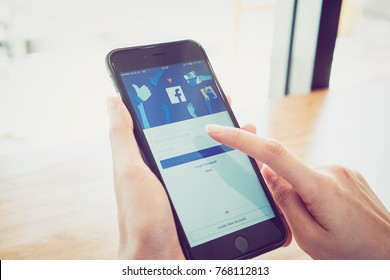 Bangkok, Thailand - December 4, 2017 : hand is pressing the Facebook screen on apple iphone6 ,Social media are using for information sharing and networking.