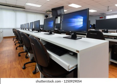 BANGKOK, THAILAND - December 4: Computer Room Thammasart University on December 4,2018 in Bangkok, Thailand. Monitors computer showing its screen with Microsoft Windows 10 for training students.