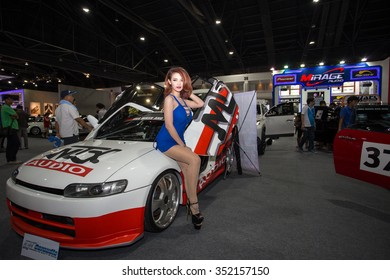 BANGKOK, THAILAND - DECEMBER 4: Unidentified model with car at The 32nd Thailand International Motor Expo on December 4, 2015 in Bangkok, Thailand.