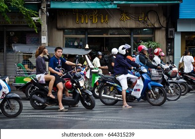 Bangkok, Thailand â?? December 6, 2015: Tuk tuk drivers ply their trade around.Bangkok Thailand is the only Southeast Asian country never to have been colonized by a European Power.