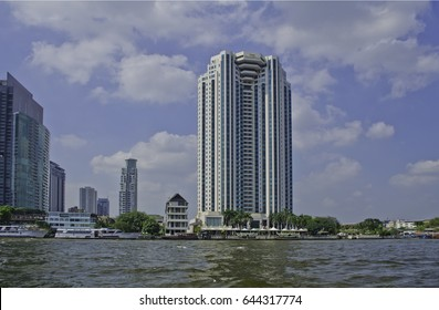 Bangkok, Thailand â?? December 6, 2015: River boat drivers ply their trade in the Chao Phraya River. Thailand is the only Southeast Asian country never to have been colonized by a European Power.