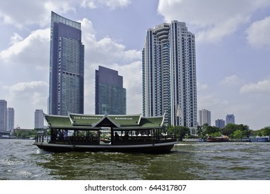 Bangkok, Thailand â?? December 6, 2015: River boat drivers ply their trade in the Chao Phraya River. Thailand is the only Southeast Asian country never to have been colonised by a European Power.
