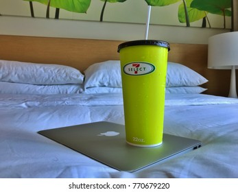BANGKOK, THAILAND - DECEMBER 6th, 2017: Picture of the 7-Elecven drinks on top of the Apple Macbook