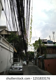 BANGKOK, THAILAND - DECEMBER 7, 2018 :   The Chaos Of Cables And Wires On Petchburi 18 Road.