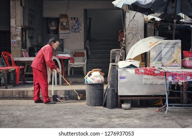 Bangkok, Thailand - December CIRCA, 2018: Lady in picture clean her quiet shop. Due to Thai economic goes down, many small business such as food shop or street food in market place have to close down.