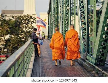 Bangkok, Thailand - December Circa, 2018: Two Buddhist monks walking in urban area of Bangkok, Capital city. Buddhism is the religion of Thailand more than 70% of Thai population are Buddhists