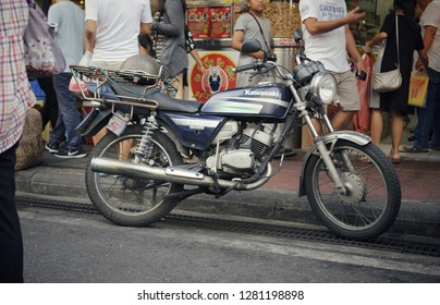 Bangkok, Thailand - December Circa, 2018: traffic solution delivery old vintage classic motorcycle use for transport goods and package around the capital city of Thailand, to avoid traffic jam.