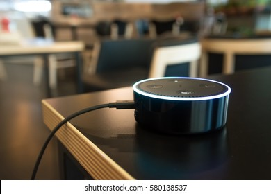 BANGKOK, THAILAND - Fabruary 2 : Selective focus on Amazon Echo dot version 2, the voice recognition streaming device from Amazon in coffee shop on Fabruary 2 2017 in BANGKOK, THAILAND
