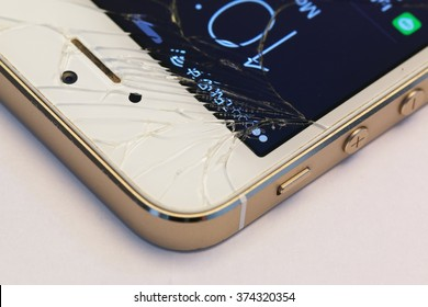 Bangkok, Thailand - Feb 01: Studio shot of an iPhone 5s with seriously broken retina display screen  on white on Feb 01, 2015. iPhone 5s is a smartphone developed by Apple Inc.