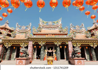 BANGKOK, THAILAND - Feb 07,2019: The big entry of China temple at Thumkatunyoo foundation and red lanterns decorations hanging on chinese temple roof with blue sky background ,Bangkok, Thailand.