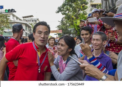 Bangkok, Thailand - FEB 1, 2014: The PDRC spokesman, Akkanat Prompan and his supporter during a march.