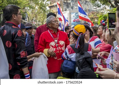 Bangkok, Thailand - FEB 1, 2014: Suthep Thaugsuban, the PDRC's Secretary-General with his supporter during a march in Bangkok's Chinatown.