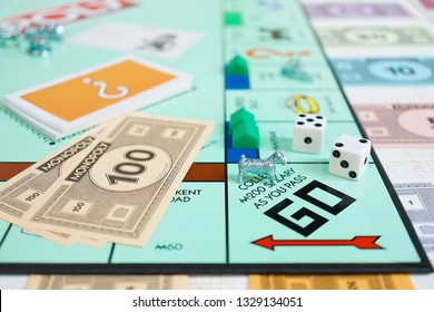 Bangkok, Thailand - Feb 11, 2019 : A monopoly board game with selective focus on the dog player. (West Highland White Terrier dog breed). Monopoly is a famous fast dealing property trading game.