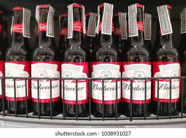 BANGKOK, THAILAND - FEB 13, 2018 : Close up shot of beer bottles of Budweiser on store shelf. Budweiser is a filtered beer available in draft and packaged forms.