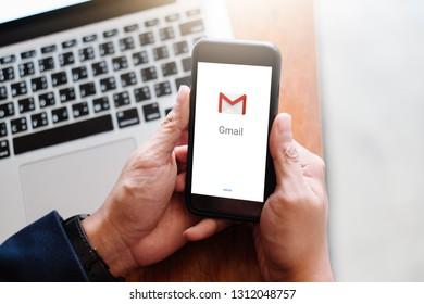 BANGKOK, THAILAND - FEB 13,2019 :Brand  Apple iphone 7 with displaying Gmail application.