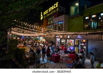 BANGKOK THAILAND - FEB 14: Box Space at Ratchayothin, the new night market in Bangkok. There are many people shopping in the market on February 14, 2016 in Bangkok, Thailand.