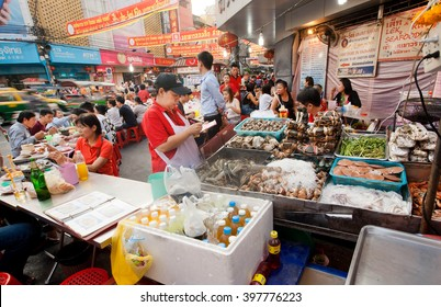 BANGKOK, THAILAND - FEB 14: Street trader of seafood market with shrimps, brines, fish and meat on February 14, 2016. Population of Bangkok is over 8 million, most populous city of Thailand.